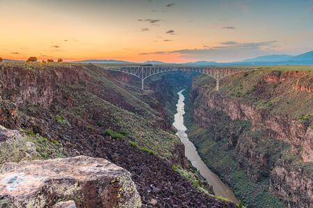 Taos, New Mexico, USA at Rio Grande Gorge Bridge over the Rio Grande at dusk.