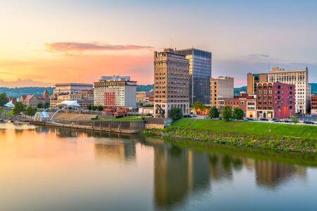 Charleston, West Virginia, USA skyline on the Kanawha River at dusk.
