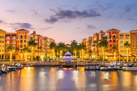 Naples, Florida, USA town skyline on the water at dusk. Imagens