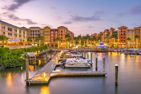 Naples, Florida, USA town skyline on the water at dusk. Stok Fotoğraf