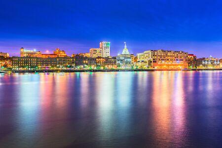 Savannah, Georgia, USA skyline on the Savannah River at dusk.