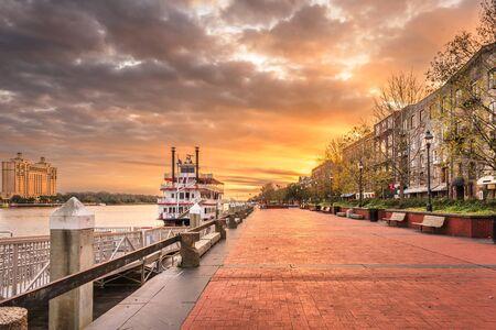 Savannah, Georgia, USA riverfront promenade at sunrise.