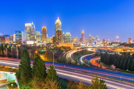 Atlanta, Georgia, USA downtown city skyline over highways at night.