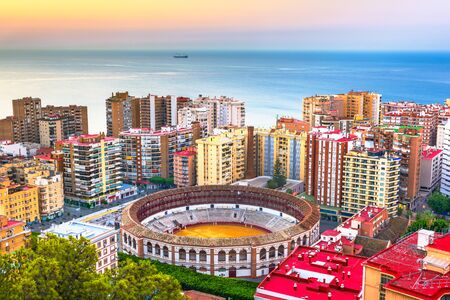 Malaga, Spain dawn skyline towards the Mediterranean Sea.