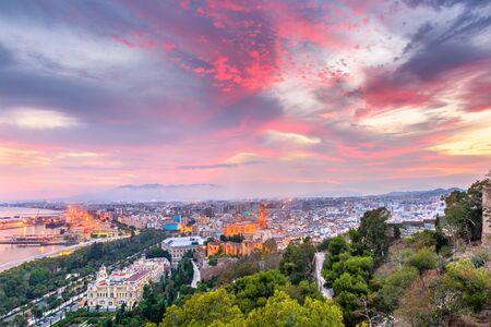 Malaga, Spain old town skyline at dusk. Фото со стока