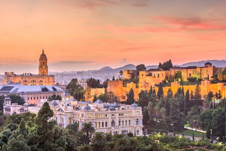 Malaga, Spain old town skyline at dusk. Stock Photo