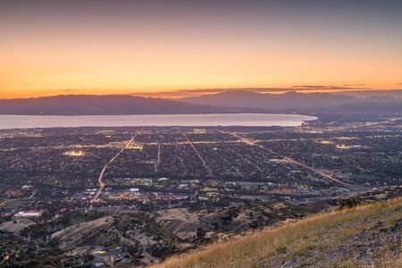 Provo, Utah, USA view of downtown from Squaw Peak during an autumn dusk.