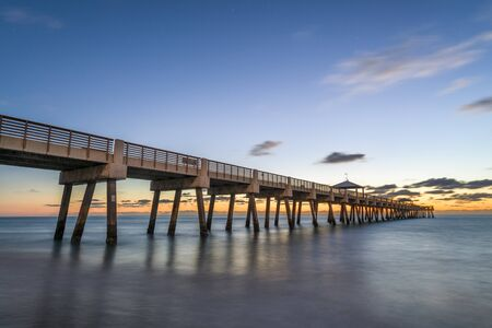 Juno, Florida, USA at the Juno Beach Pier just before sunrise. Фото со стока