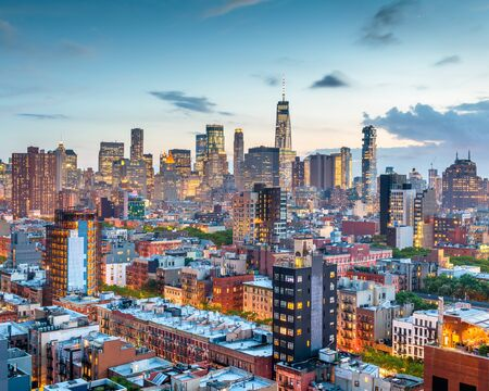 New York, New York, USA Financial district skyline from the Lower East Side at dusk.