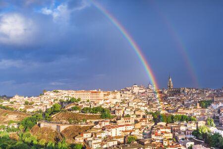 Toledo, Spain old town city skyline with a rainbow. Фото со стока