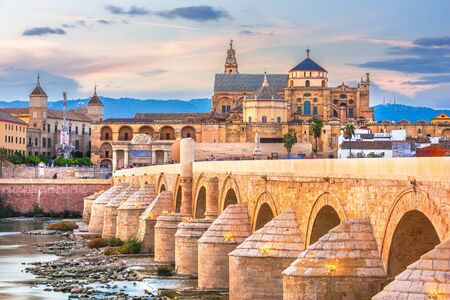 Cordoba, Spain at the Roman Bridge and Mosque-Cathedral on the Guadalquivir River.