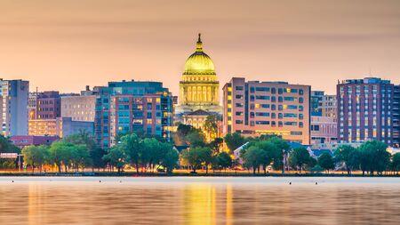 Madison, Wisconsin, USA downtown skyline at dusk on Lake Monona.