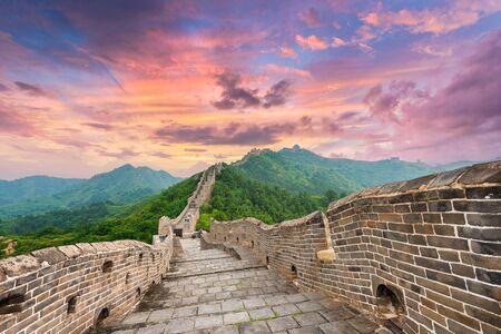 Great Wall of China at the Jinshanling section at dusk. Фото со стока
