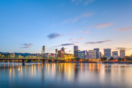 Portland, Oregon, USA skyline at dusk on the Willamette River. Фото со стока