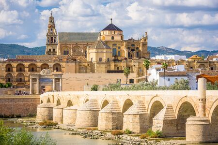 Cordoba, Spain at the Roman Bridge and Mosque-Cathedral on the Guadalquivir River. Reklamní fotografie - 132219332
