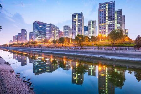 Beijing, China CBD city skyline and canal at night. Фото со стока