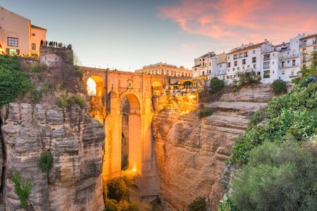 Ronda, Spain at Puente Nuevo Bridge at sunset
