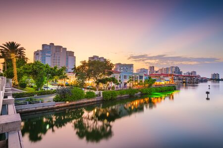 Naples, Florida, USA downtown skyline and canals at dusk.