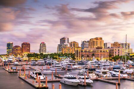 West Palm Beach, Florida, USA downtown skyline on the Intracoastal Waterway at dusk. Фото со стока