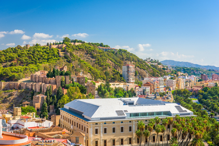 Malaga, Spain cityscape and Alcazaba in the day.