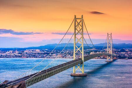Kobe, Japan at Akashi Kaikyo Bridge at dusk over the Seto Inland Sea.