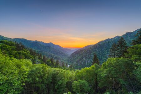Newfound Gap in the Great Smoky Mountains National Park, straddling the border of Tennessee and North Carolina after sunset in the summer.