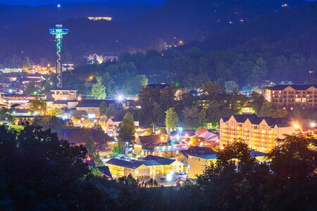 Gatlinburg, Tennessee, USA town skyline in the Smoky Mountains at night.