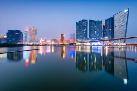 Macau, China cityscape at twilight on Nam Van Lake.