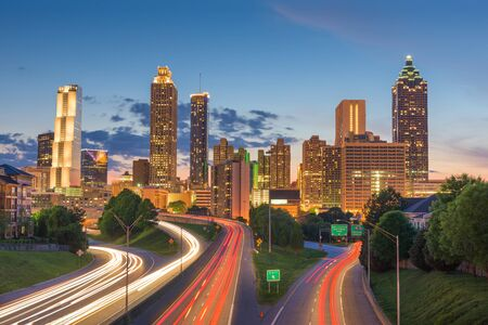 Atlanta, Georgia, USA downtown city skyline over Freedom Parkway at dusk.