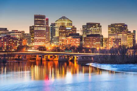 Rossyln, Arlington, Virginia, USA downtown city skyline at dusk on the Potomac River.