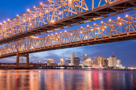 New Orleans, Louisiana, USA at Crescent City Connection Bridge over the Mississippi River at night.