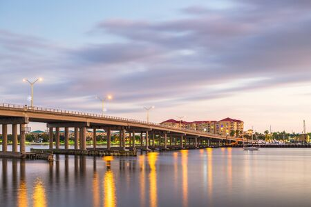 Bradenton, Florida, USA downtown on the Manatee River at dusk.
