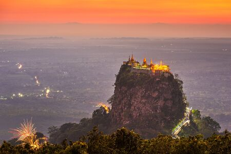 Taung Kalat Monastery on Mt. Popa, Myanmar at dusk.