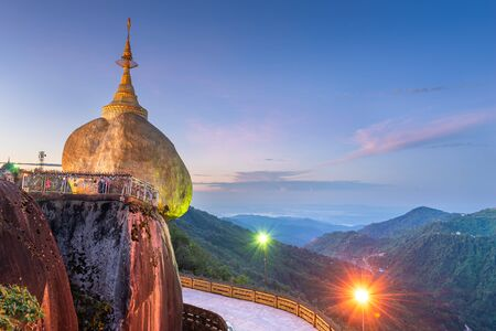 Golden Rock of Mt. Kyaiktiyo, Myanmar during a hazy sunset.