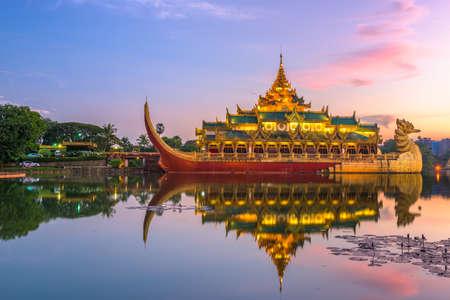 Yangon, Myanmar at Karaweik Palace in Kandawgyi Royal Lake at dusk.