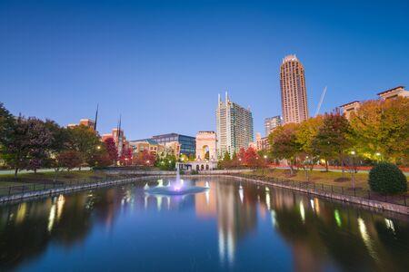 Atlanta, Georgia, USA city skyline from Atlantic Station at dusk with autumn foliage.