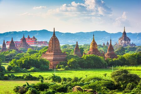 Bagan, Myanmar ancient temple ruins landscape in the archaeological zone in the afternoon.