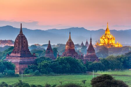 Bagan, Myanmar temples in the Archaeological Zone at dusk.