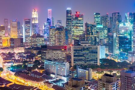 Singapore Financial District skyline at night.