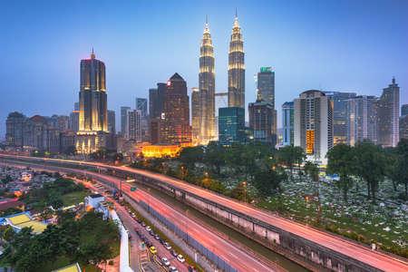 Kuala Lumpur, Malaysia highways and skyline at night.