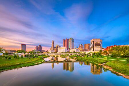 Columbus, Ohio, USA skyline on the river at dusk.
