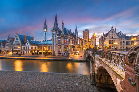 Ghent, Belgium old town cityscape from the Graslei are at dawn.