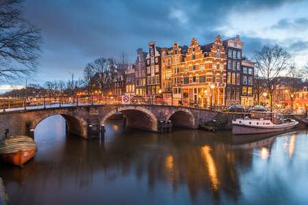 Amsterdam, Netherlands bridges and canals at twilight. Stok Fotoğraf