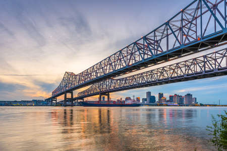 New Orleans, Louisiana, USA at Crescent City Connection Bridge over the Mississippi River at dusk. Stok Fotoğraf