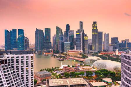 The city skyline of Singapore over the Marina during dusk. Stok Fotoğraf