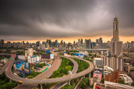 Bangkok, Thailand urban cityscape and office towers at dusk.