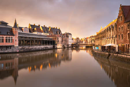 Ghent, Belgium old town cityscape on the Leie River at dusk.