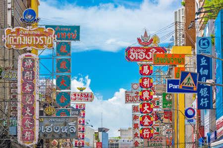 BANGKOK, THAILAND - SEPTEMBER 27, 2015: Colorful signs line Yaowarat Road in the Chinatown district of Bangkok.