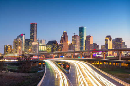 Houston, Texas, USA downtown skyline over the highways at dusk. Imagens