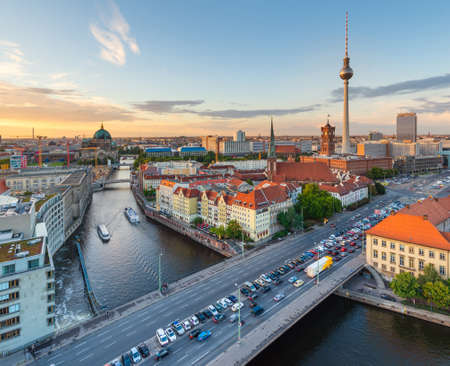 Berlin, Germany viewed from above the Spree River at dusk.
